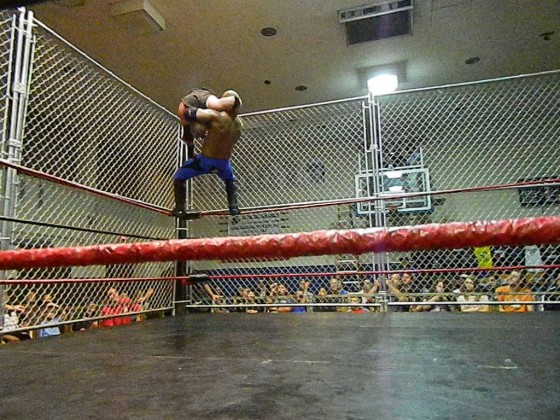 Reyes with a superplex on Amazing Red