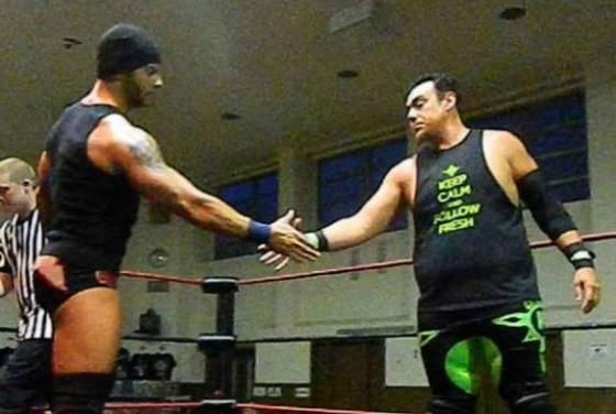 Jason Static and K-Fresh shake hands