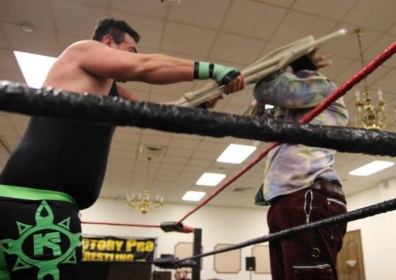 K-Fresh Kevin Fulton smashing Jacob Hendrix with a chair