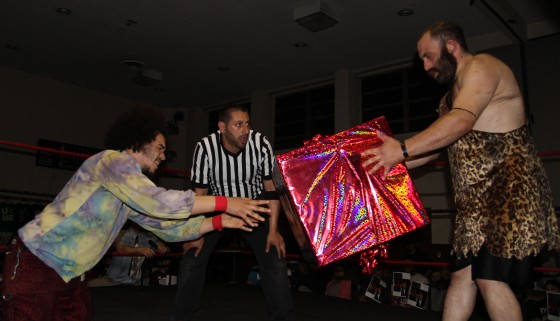 "Jacob Hendrix giving Grop the Caveman a ""gift"" during their match"