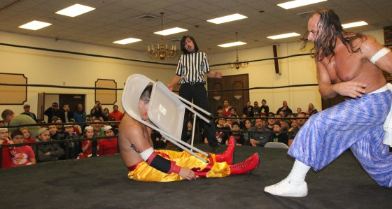 Sabu showing his dominance with a chair to the face of Kai Katana